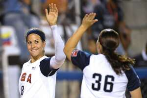 USA softball players Cat Osterman (L) and Alisa Habre greet each other at the end of their 12th Women's Softball World Championship game, in Caracas on July 1, 2010.  The USA won 4-0.  AFP PHOTO/Miguel Gutierrez (Photo credit should read MIGUEL GUTIERREZ/AFP/Getty Images)