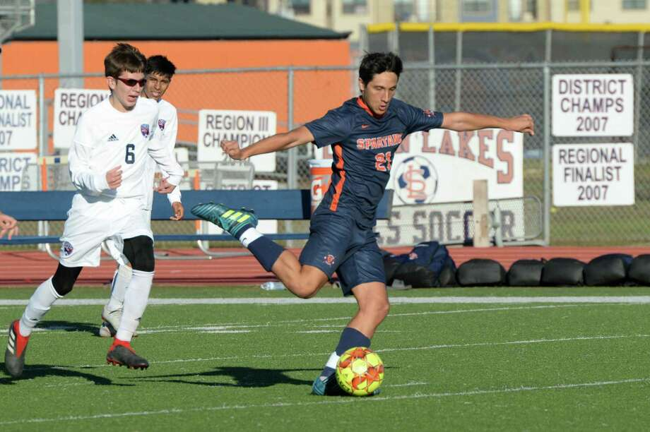 Vicente Garcia (21) of Seven Lakes takes a shot on goal during the first half of a high school soccer game between the Seven Lakes Spartans and the Aldine Davis Falcons on Saturday, Jan. 5, 2019, at Seven Lakes High School in Katy. Photo: Craig Moseley, Houston Chronicle / Staff Photographer / ©2019 Houston Chronicle