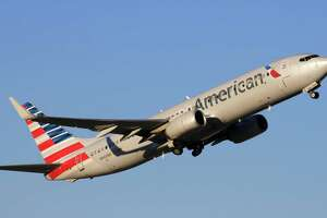 An American Airlines Boeing 737 takes off from Bush Intercontinental Airport.