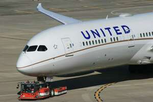 A United Airlines is towed to a gate at Bush Intercontinental Airport.
