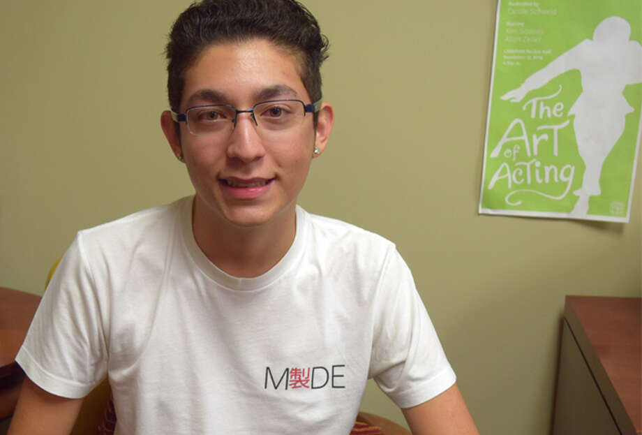 University of Bridgeport student David Alvarez modeling the T-shirts from his MADE Clothings line. Photo: Phil Hall
