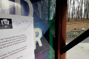 A sign is seen posted on an information board alerting visitors of reduced staff at the Saratoga National Historical Park on Monday, Jan. 7, 2019, in Stillwater, N.Y. A person hand wrote a comment about President Donald Trump.  (Paul Buckowski/Times Union)