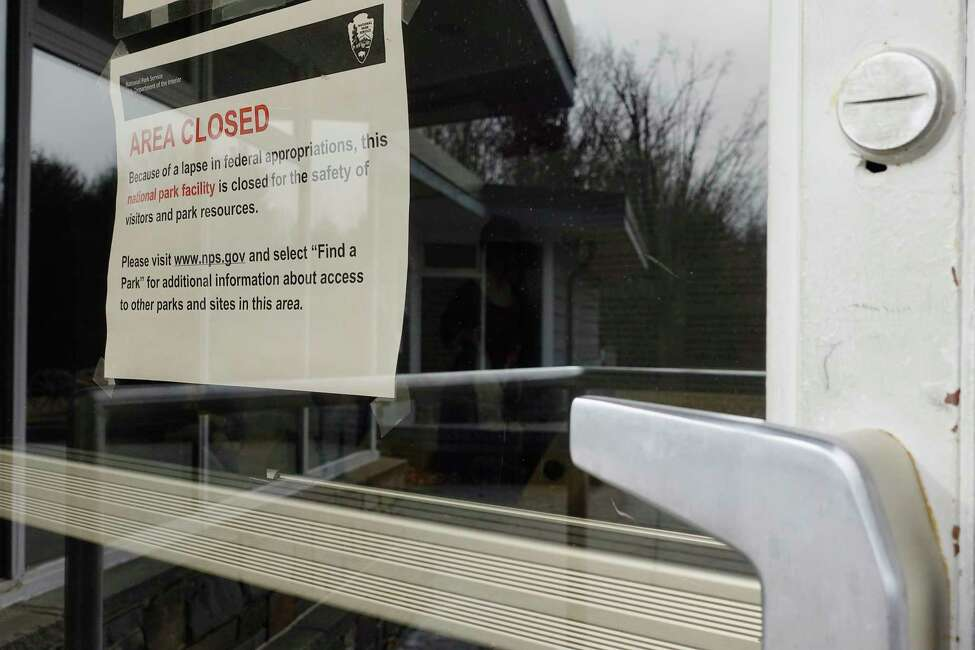 A sign is seen posted on on the door to the visitor center alerting people that the center is closed at the Saratoga National Historical Park on Monday, Jan. 7, 2019, in Stillwater, N.Y. (Paul Buckowski/Times Union)