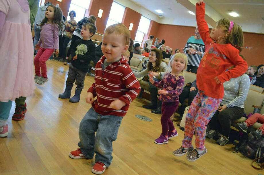 Charlie Horn, 2, and Harper Campbell, 4, both of Darien, dancing hard at the performance of Songs for Seeds at Darien Library on Friday, Jan. 4, 2019, in Darien, Conn. Photo: Jarret Liotta / For Hearst Connecticut Media / Darien News Freelance
