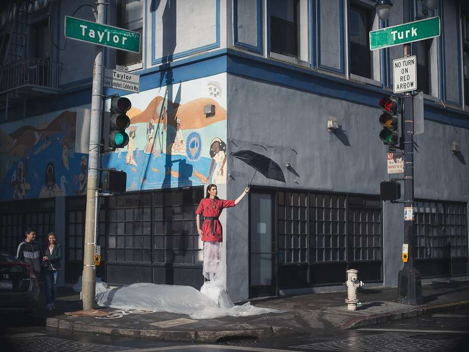 """An image, titled """"Transvisual,"""" styled by Nina Vo for a City College of San Francisco project. The model, Alida Pepper, holds an umbrella on the corner of Taylor and Turk streets, near Aunt Charlie's Lounge in the Tenderloin. Photo: Travis Cislo"""