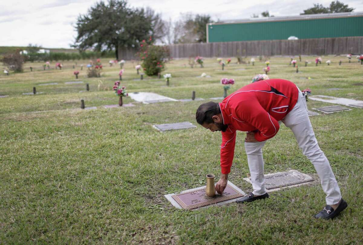 Yousuf Beg cleans his father's grave at Forest Lawn Cemetery, Wednesday, Nov. 28, 2018, in Houston. Beg said that his father had no will when he died, which is a common occurrence in American-Muslim families.