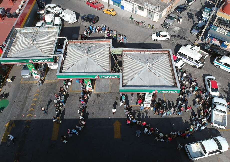 People line up to buy gasoline at a station in Morelia. The city in Michoacan state is among towns mainly in central states that have suffered gas shortages. Photo: Enrique Castro / AFP / Getty Images