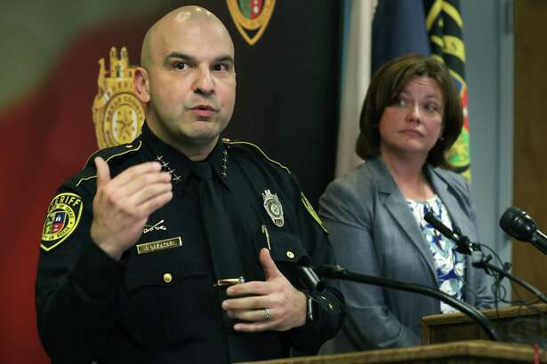 Bexar County Sheriff Javier Salazar, left, announces the hire of law enforcement psychologist Dr. Brandi Burque, right, to provide treatment to deputies, teach in the academy and help during crisis situations, on Jan. 7.