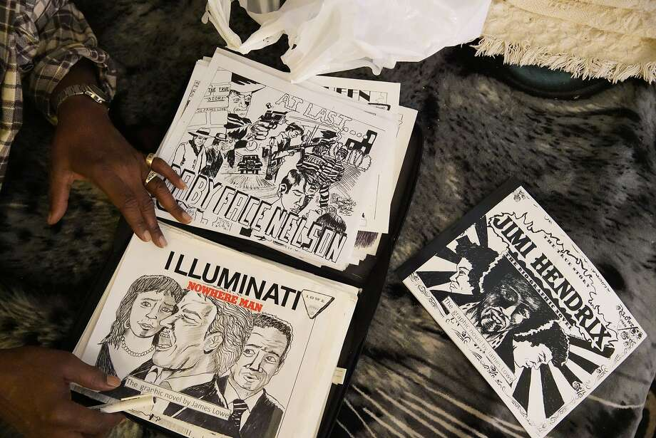 James Lowe displays some of the covers from his graphic novels at his San Francisco home. Photo: Lea Suzuki / The Chronicle