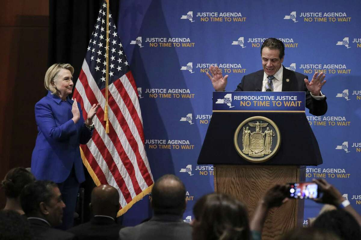 NEW YORK, NY - JANUARY 7: (L-R) Former Secretary of State Hillary Clinton applauds as New York Governor Andrew Cuomo speaks about reproductive rights at Barnard College, January 7, 2019 in New York City. The two Democrats shared the stage to promote the Reproductive Health Act in New York, which Cuomo wants the State Legislature to pass in their first 30 days. Under New York's current law, abortions after 24 weeks are illegal unless its necessary to save the woman's life.