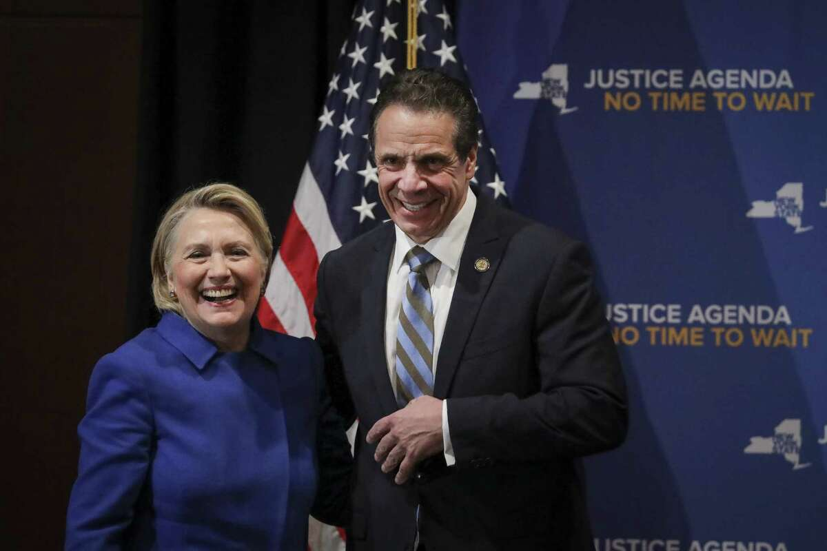 NEW YORK, NY - JANUARY 7: (L-R) Former Secretary of State Hillary Clinton and New York Governor Andrew Cuomo smile at the end of an event to discuss reproductive rights at Barnard College, January 7, 2019 in New York City. The two Democrats shared the stage to promote the Reproductive Health Act in New York, which Cuomo wants the State Legislature to pass in their first 30 days. Under New York's current law, abortions after 24 weeks are illegal unless its necessary to save the woman's life.