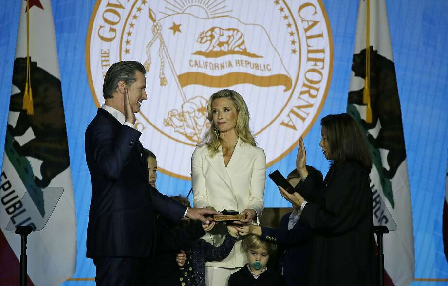 California Governor Gavin Newsom takes the oath of office from state Supreme Court Chief Justice Tani Gorre Cantil-Sakauye as his wife Jennifer Siebel Newsom looks on during his inauguration Monday, Jan. 7, 2019, in Sacramento, Calif. (AP Photo/Eric Risberg) Photo: Eric Risberg / Associated Press