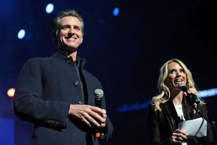 California Governor-Elect Gavin Newsom and his wife, Jennifer Siebel Newsom, during California Rises benefit concert at Golden 1 Center in Sacramento, Calif. on Sunday, January 6, 2019.