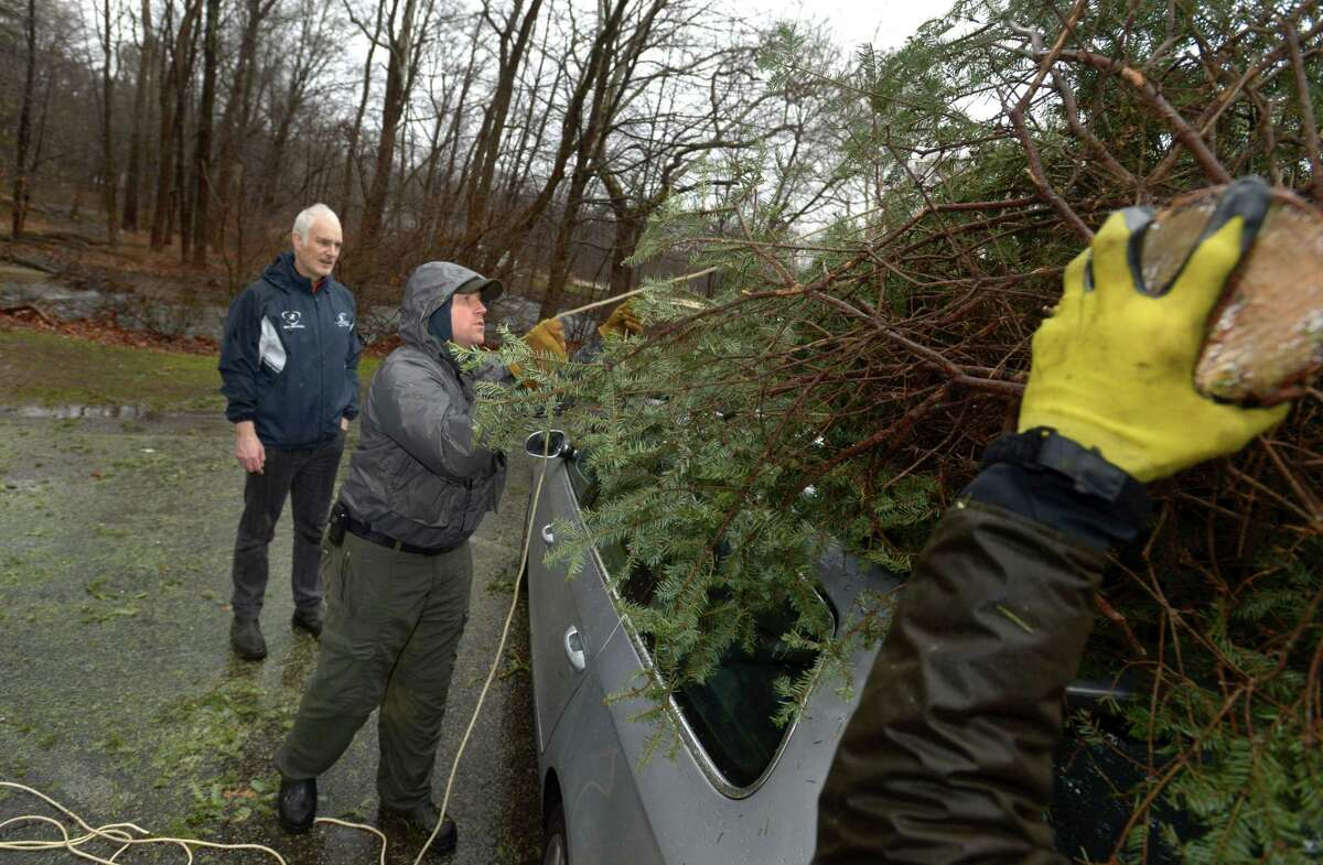 Trout Unlimited Chapter president Ben Coach unloads a Christmas tree for Wilton resident Ambrose Kelly for the Mianus Chapter of Trout Unlimited Trees for Trout Collection Saturday, Janaury 5, 2018, where volunteers