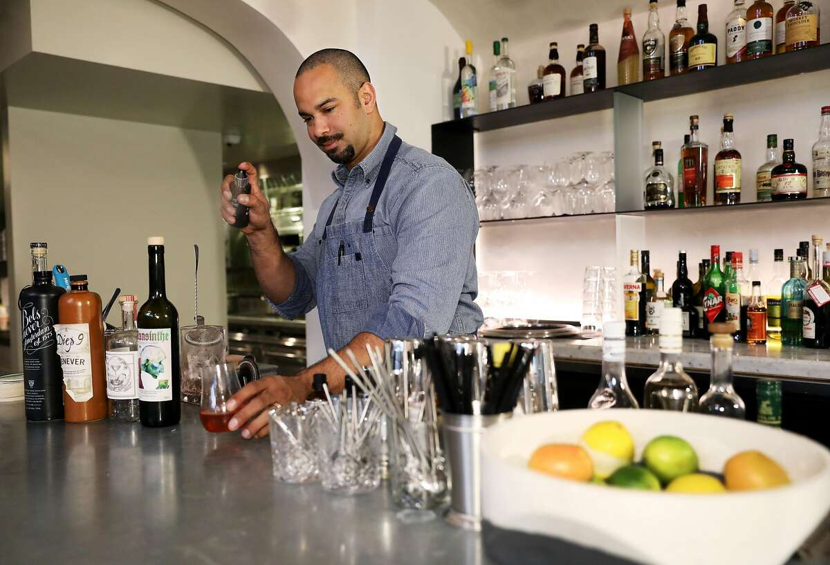 Bar director Julian Cox makes the cocktail Genever Sazerac at Ayala, located at 398 Geary St., in San Francisco, Calif., on Saturday, January 5, 2019. The drink includes rye gin, Ayala Genever Blend Mezcal and Mansinthe.