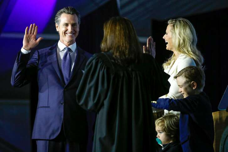 Governor-elect Gavin Newsom takes the oath of office during his inauguration ceremony in Sacramento, California, on Monday, January 7th, 2019.