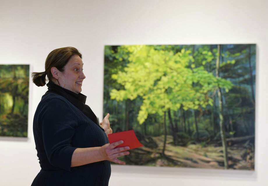 "Artist Amy Talluto speaks about her work on display in the ""Forces of Nature"" exhibition at Greenwich Library's Flinn Gallery in Greenwich, Conn. Sunday, Jan. 6, 2019. The exhibition, which runs through January 23, shows how the beauty and wonder of nature provides endless visual influences and opens possibilities for art making. Work by artists Amy Talluto, Rebecca Hutchinson and Elena Lyakir is on display. Photo: Tyler Sizemore / Hearst Connecticut Media / Greenwich Time"