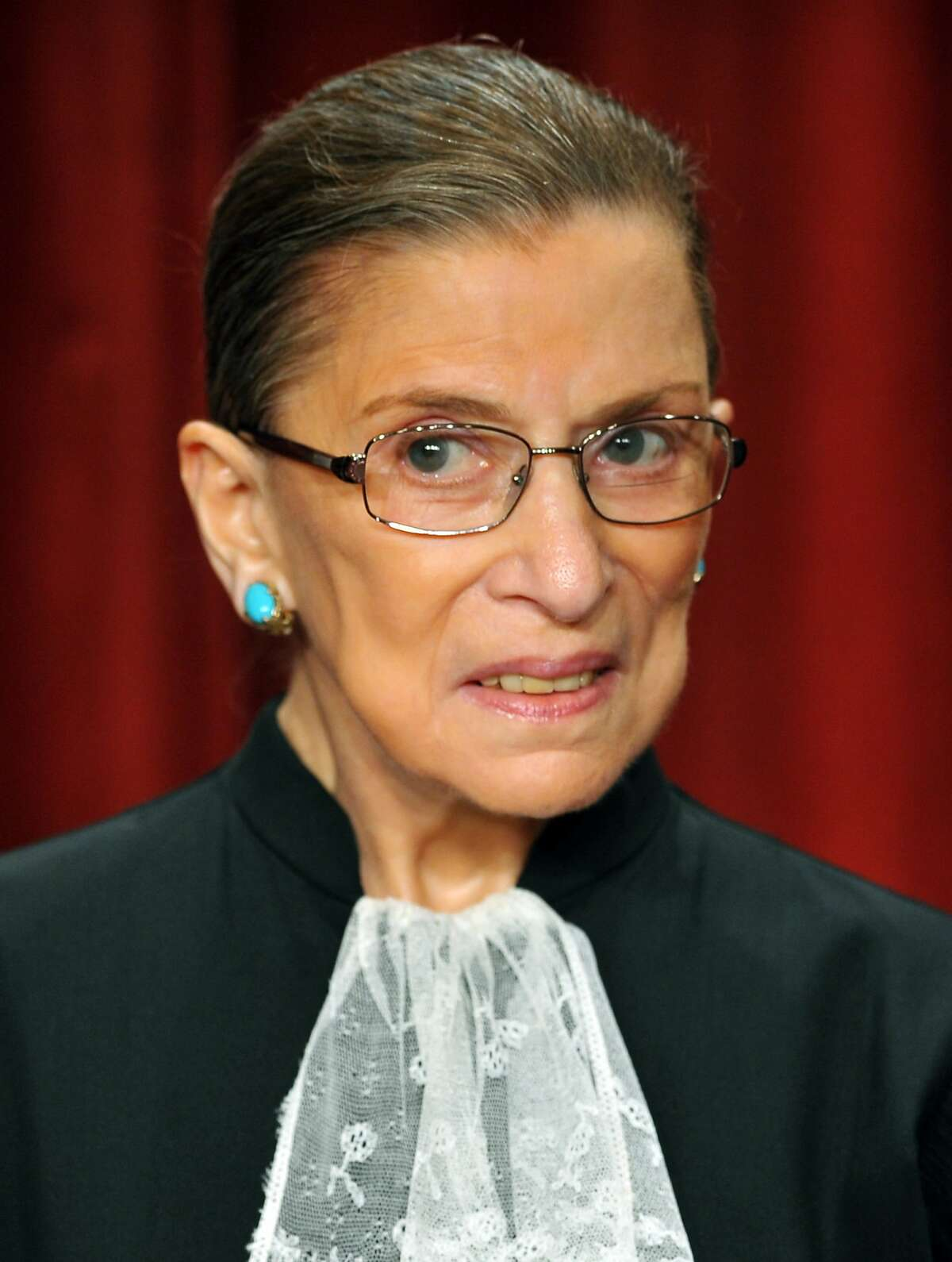 This September 29, 2009 file photo shows US Supreme Court Justice Ruth Bader Ginsburg during a group photo in the East Conference Room of the Supreme Court in Washington, DC.