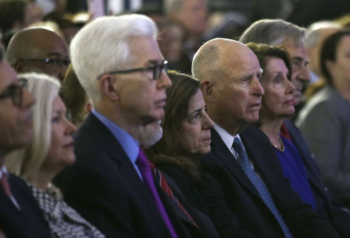 From left, former California first lady Sharon Davis, former governor Gray Davis, first lady Anne Gust Brown, Governor Jerry Brown, Speaker of the House Nancy Pelosi and her husband Paul Pelosi watch the inauguration of California Governor Gavin Newsom Monday, Jan. 7, 2019, in Sacramento, Calif.
