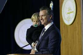 California Governor Gavin Newsom holds his son, Dutch, while speaking during his inauguration Monday, Jan. 7, 2019, in Sacramento, Calif. (AP Photo/Rich Pedroncelli)