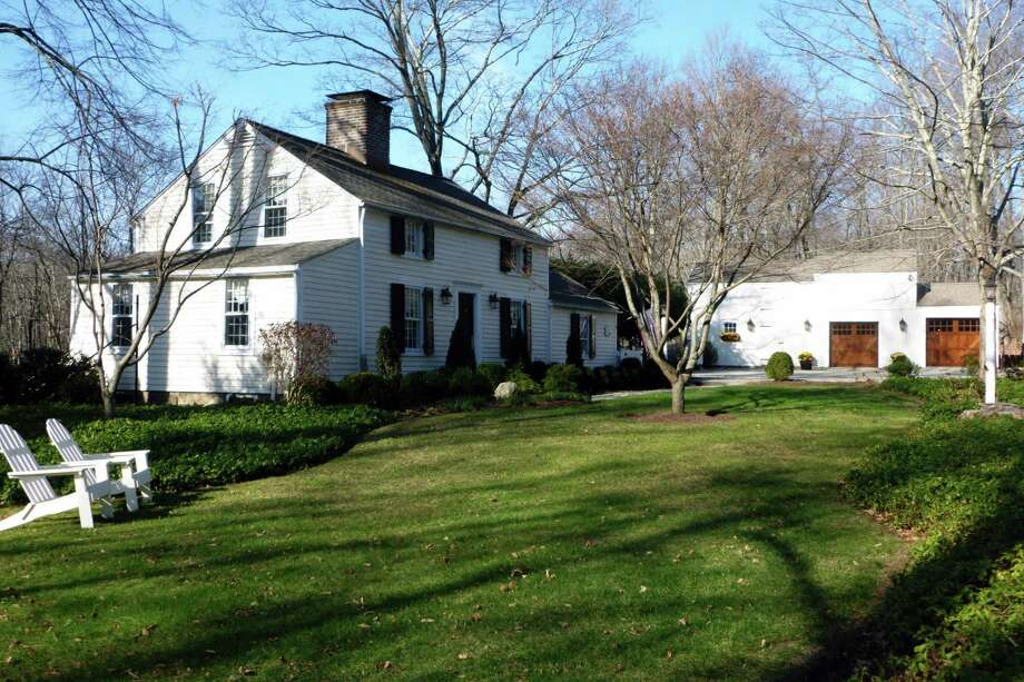 "The Colonial Revival style house at 651 Nod Hill Road was built circa 1825 but is ""well preserved"" and is more an expression of the 20th rather than the 18th century. It also features a barn/two-car garage. Photo: Contributed Photo"