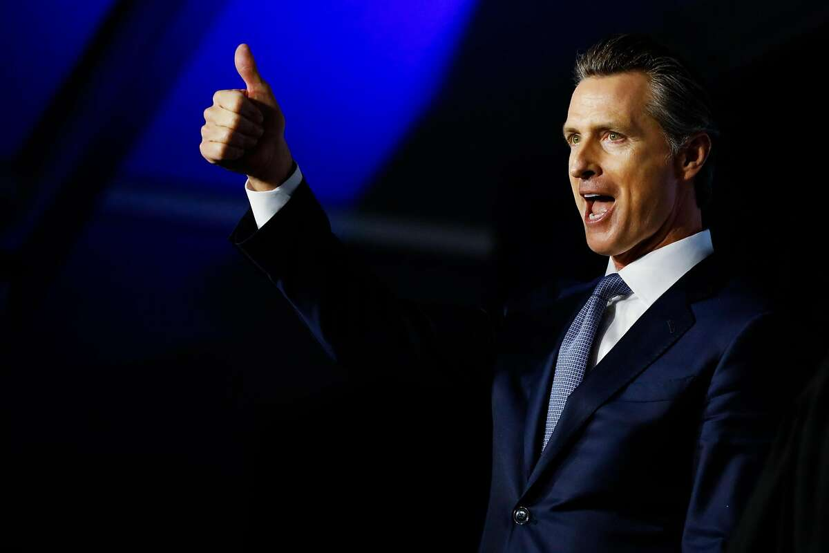 Governor Gavin Newsom gives a thumbs-up to the crowd after taking the oath of office during his inauguration ceremony in Sacramento, California, on Monday, January 7th, 2019.