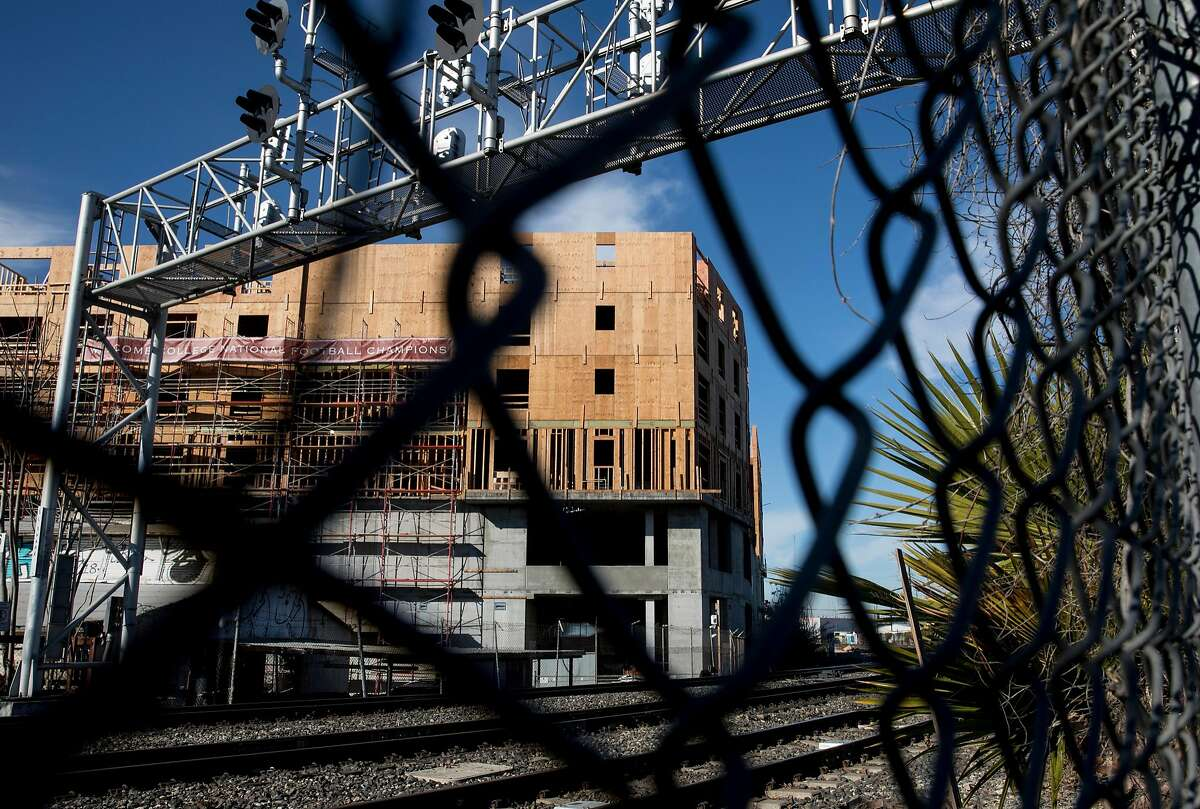New construction is seen across the Diridon Station tracks near a fence adjacent to the SAP Center parking lot in San Jose, Calif. Friday, Jan. 4, 2019.