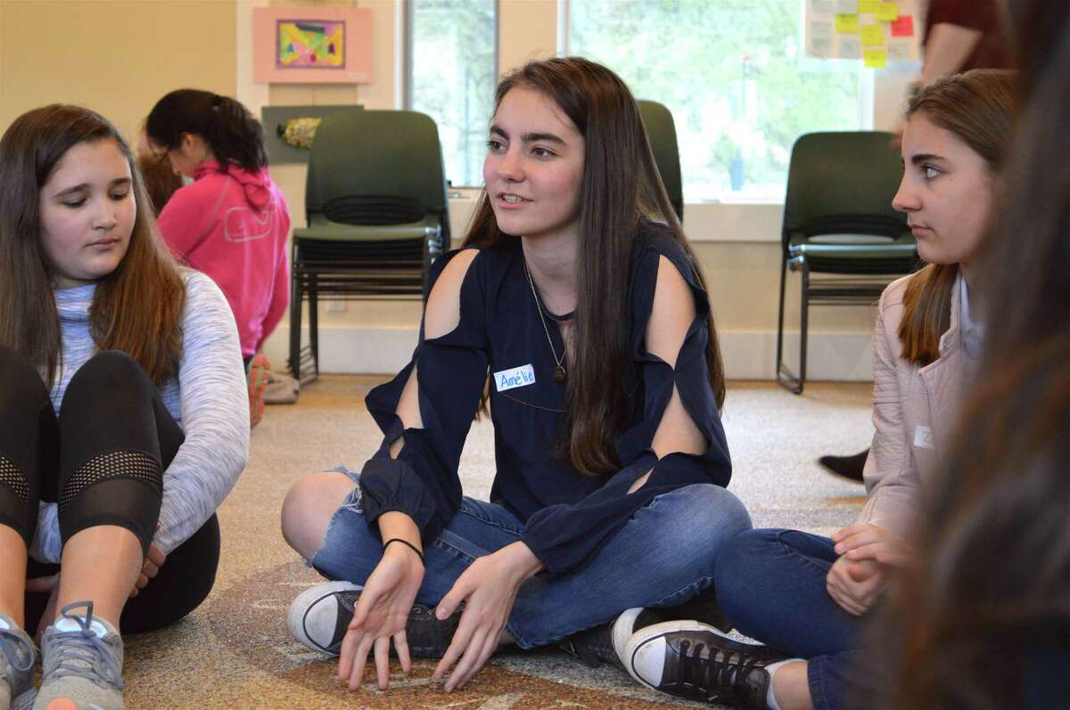 """Amelie L'Henaff, 13, of New Canaan, talks about the issue of gun control during a small group discussion at the local nonprofit LiveGirl's leadership summit """"Your Voice Matters"""" held at the New Canaan Nature Center on Friday, April 27, 2018, in New Canaan, Conn."""