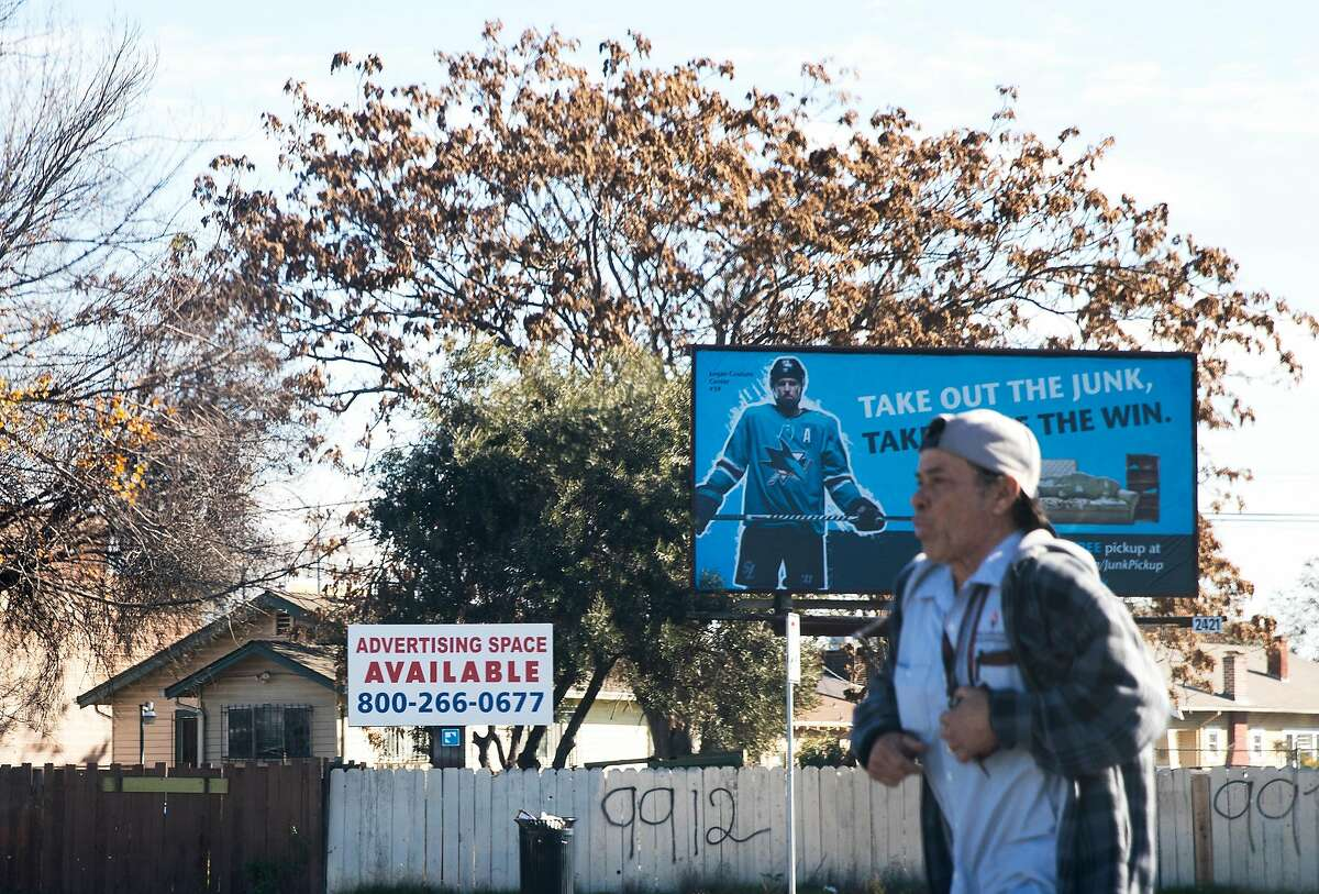 A dilapidated fence and advertisement signage is seen at the corner of West San Carlos Street and South Montgomery Street near the San Jose Diridon Train Station in San Jose, Calif. Friday, Jan. 4, 2019.