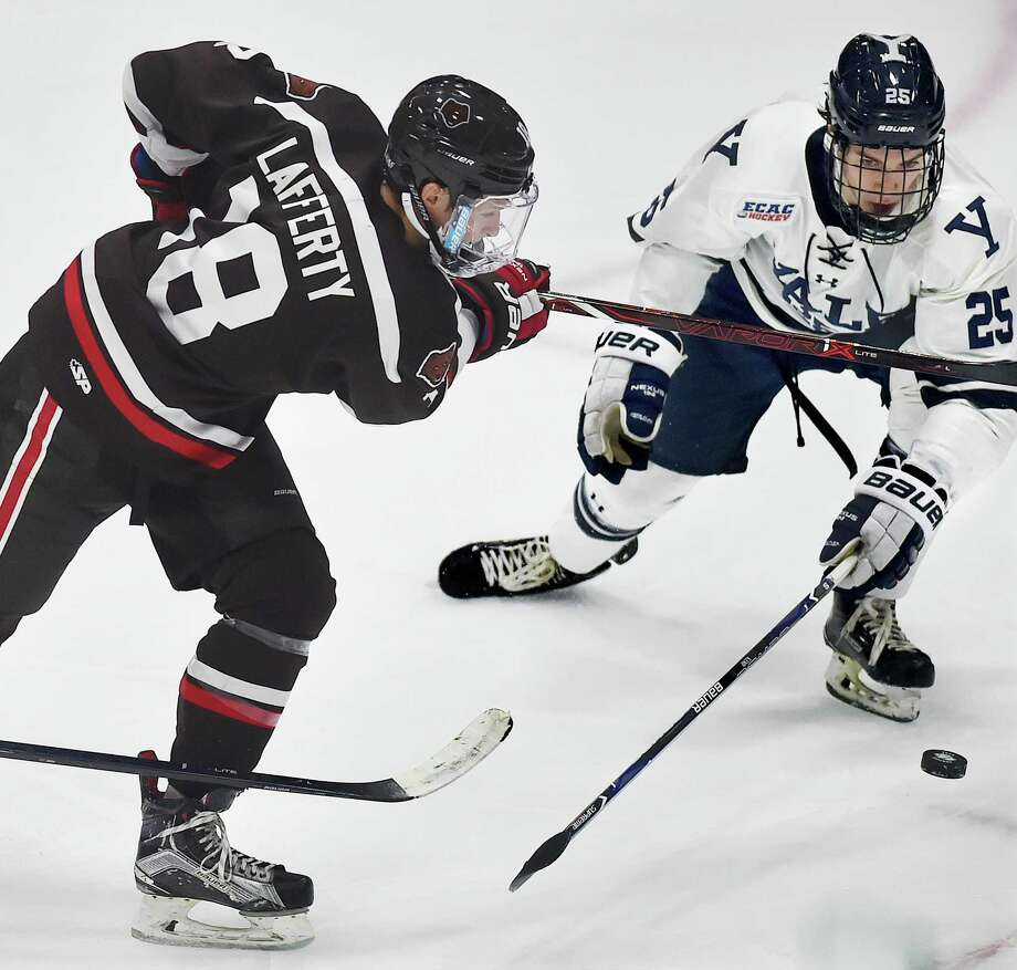 Yale defenseman Phil Kemp, right, is back with Yale after winning a silver medal at the World Junior Championships. Photo: Catherine Avalone / Hearst Connecticut Media File Photo / New Haven Register