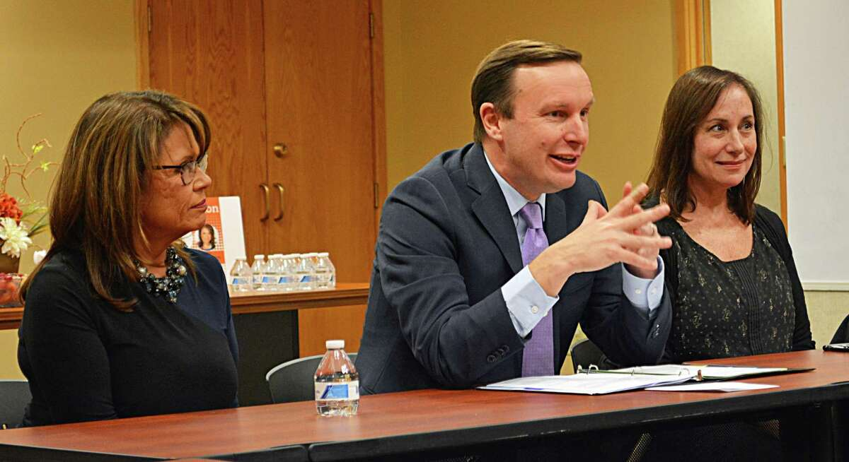 U.S. Sen. Chris Murphy, center, met with a large number of individuals who work with homeless teens at The Connection in Middletown Monday. Last month, Connecticut received $6.5 million from the U.S. Department of Housing and Urban Development to fund a new Youth Homelessness Demonstration Program. At left is Lisa DeMatteis-Lepore, CEO of The Connection, and at right, Mary Ann