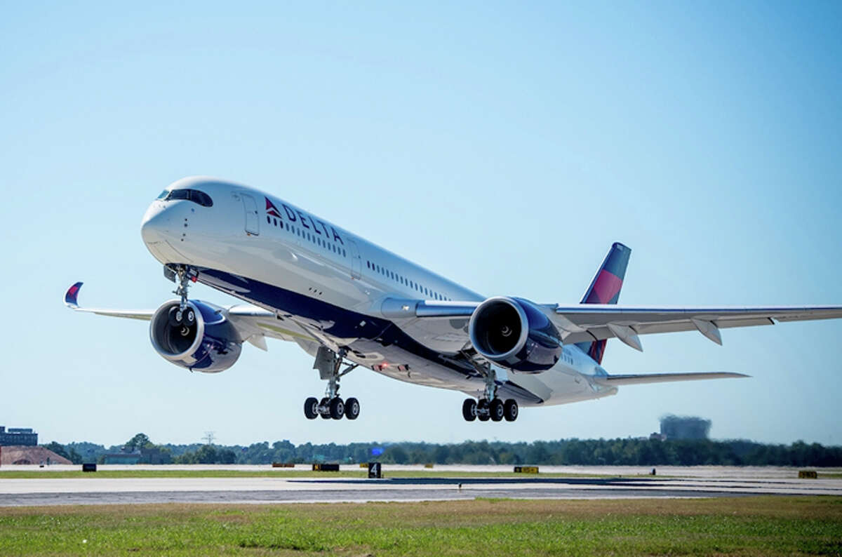 """A Delta Airbus A350- see the """"raccoon eyes"""" and rounded outer edge of cockpit windows? The wingtips also curl up. Learn how to spot more planes in our quiz below!"""