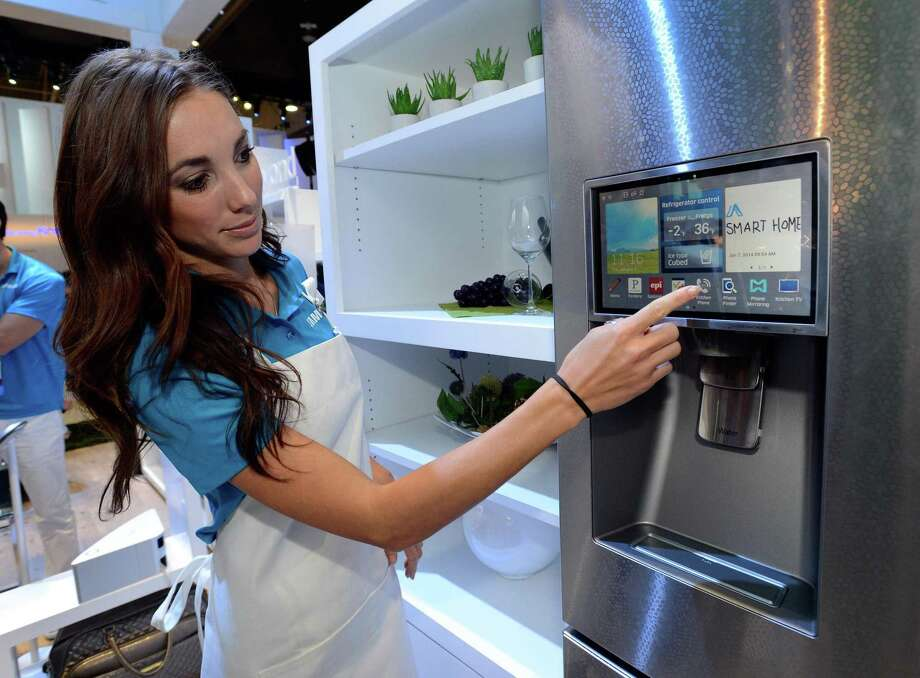 Samsung's latest line of smart refrigerators is voice- enabled and comes with an app that lets you check its contents while at the grocery store. Photo: David Becker, Stringer / Getty Images / 2014 Getty Images