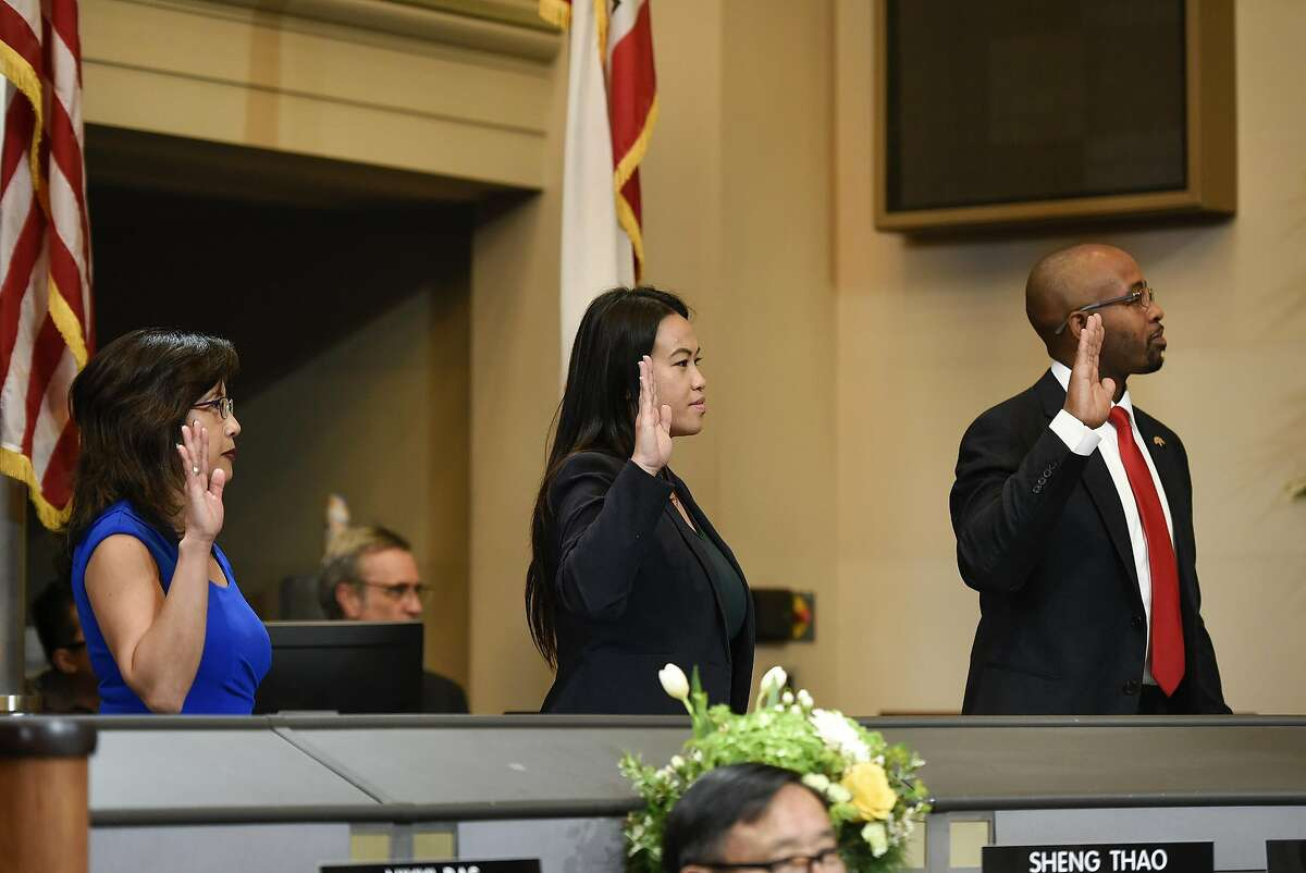 Oakland city council members Nikki Fortunato Bas, left, Sheng Thao, and Loren Taylor are sworn in during an inauguration ceremony for elected representatives at City Hall in Oakland, Calif., on Monday, January 7, 2019.