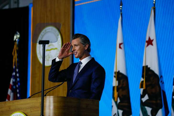 Governor Gavin Newsom salutes to the crowd after taking the oath of office during his inauguration ceremony in Sacramento, California, on Monday, January 7th, 2019.