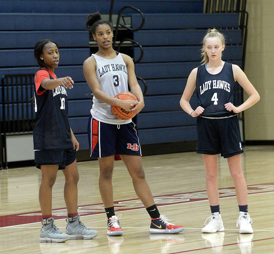 Hardin-Jefferson freshman varsity player Ashlon Jackson runs a drill with Asia Wheeler as the Lady Hawks practice Wednesday. 