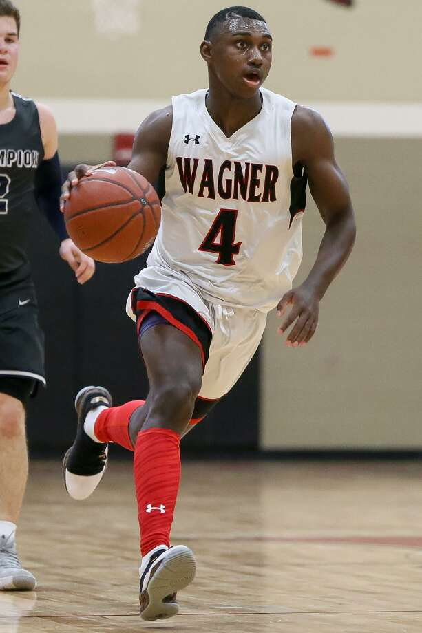 Wagner's Jalen Jackson brings the ball upcourt during the second half of their District 26-5A boys basketball game with Boerne Champion at Wagner on Friday, Jan. 4, 2019. Wagner remained undefeated in district play at 6-0 with a 73-64 over Champion. Photo: Marvin Pfeiffer, Staff Photographer / Express-News 2019