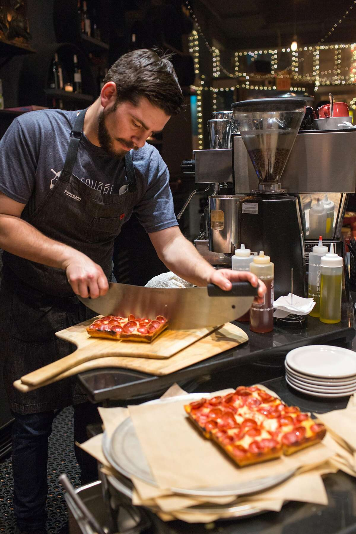 Marc Schechter, a chef, slices the pizza. Marc Schechter and Danny Stoller are the two guys behind the new pizza pop-up that specializes in Detroit style pizza, a newly popularized regional style baked in rectangular pans. Their last pop-up of 2018 was at Vinyl, on Friday, December 21, 2018 in San Francisco, Calif.