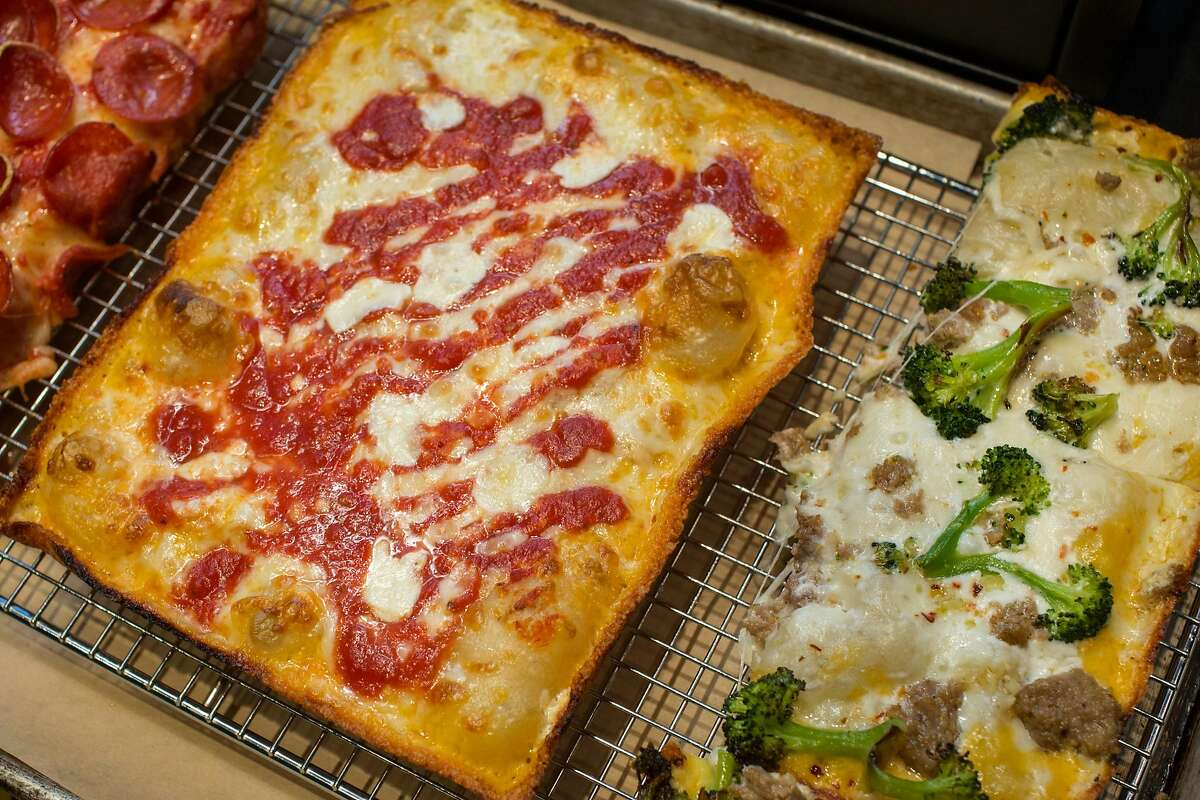 Detroit style pizza, right after it was taken out of the oven. Marc Schechter and Danny Stoller are the two guys behind the new pizza pop-up that specializes in Detroit style pizza, a newly popularized regional style baked in rectangular pans. Their last pop-up of 2018 was at Vinyl, on Friday, December 21, 2018 in San Francisco, Calif.