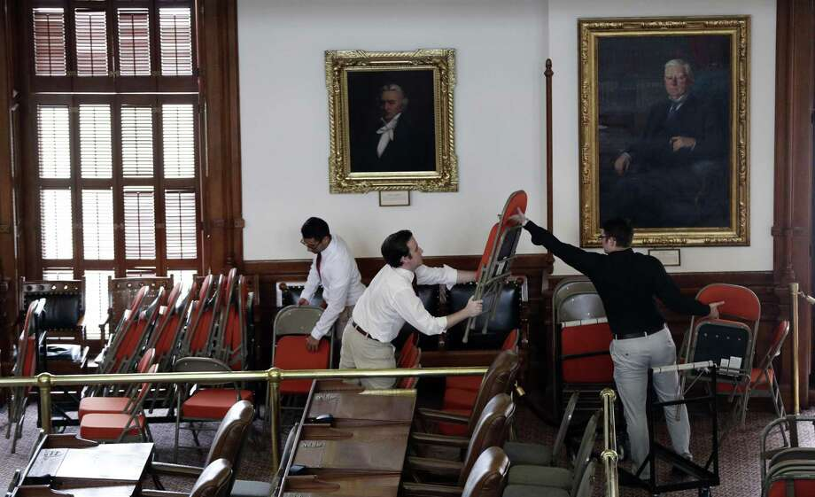 Workers place extra seating in the House Chamber at the Texas State Capitol, Monday, Jan. 7, 2019, in Austin, Texas. The 86th Texas Legislative session begins Tuesday. (AP Photo/Eric Gay) Photo: Eric Gay, STF / Associated Press / Copyright 2019 The Associated Press. All rights reserved.
