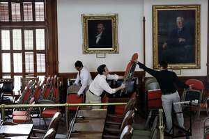 Workers place extra seating in the House Chamber at the Texas State Capitol, Monday, Jan. 7, 2019, in Austin, Texas. The 86th Texas Legislative session begins Tuesday. (AP Photo/Eric Gay)