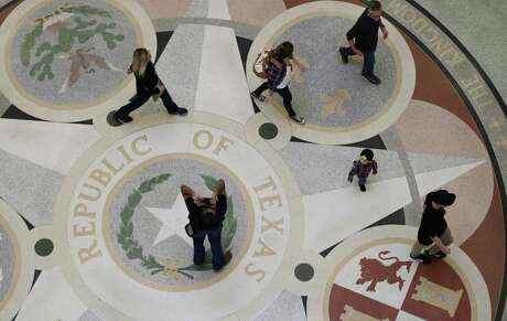 Guests pass through the rotunda at the Texas State Capitol in Austin on  Jan. 7, 2019.