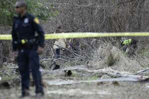 San Antonio police personnel search an area along Leon Creek at Rodriguez County Park while looking for evidence that might pertain to 8-month-old King Jay Davila on Jan. 6, 2019. The child's father, Christopher Davila, told police his car was stolen within his son inside on Jan. 4 from a West Side convenience store parking lot.