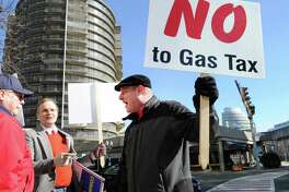 """""""No to Gas Tax"""" reads a sign held by a Stamford trucking company owner Patrick Sasser during a protest against tolls, a new gas tax and tire tax, held in front of the Stamford Government Center in February."""