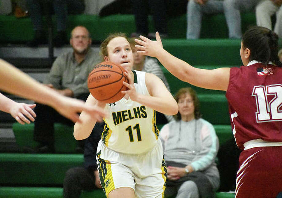 Metro-East Lutheran's Caitlyn Reynolds drains a 3-pointer just before the buzzer at the end of the second quarter. Photo: Matt Kamp/Intelligencer