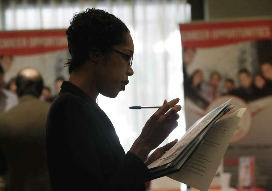 FILE- In this Jan. 30, 2018, file photo, Joana Dudley, of Lauderhill, Fla., looks at her list of job prospects at a JobNewsUSA job fair in Miami Lakes, Fla.  NEXT: See high-paying jobs that don't require a college degree. Photo: Lynne Sladky, STF / Associated Press / Copyright 2018 The Associated Press. All rights reserved.