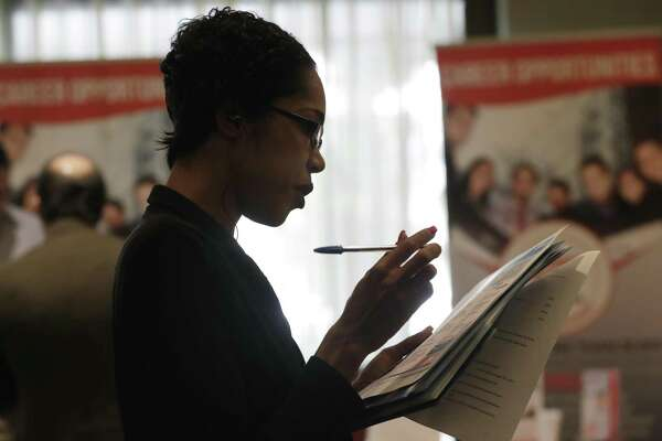 FILE- In this Jan. 30, 2018, file photo, Joana Dudley, of Lauderhill, Fla., looks at her list of job prospects at a JobNewsUSA job fair in Miami Lakes, Fla. U.S. employers likely hired at a healthy pace in August, emboldened by brisk consumer spending and an economy that keeps growing steadily. (AP Photo/Lynne Sladky, File)