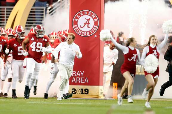 Alabama head coach Nick Saban leads the Crimson Tide on to the field before playing Clemson during College Football Playoff championship game at Levi's Stadium in Santa Clara, Calif. on Monday, January 7, 2019.