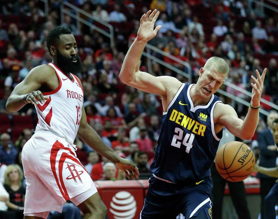 896d37e4887 PHOTOS  Rockets vs. Nuggets Denver Nuggets forward Mason Plumlee (24) loses  the