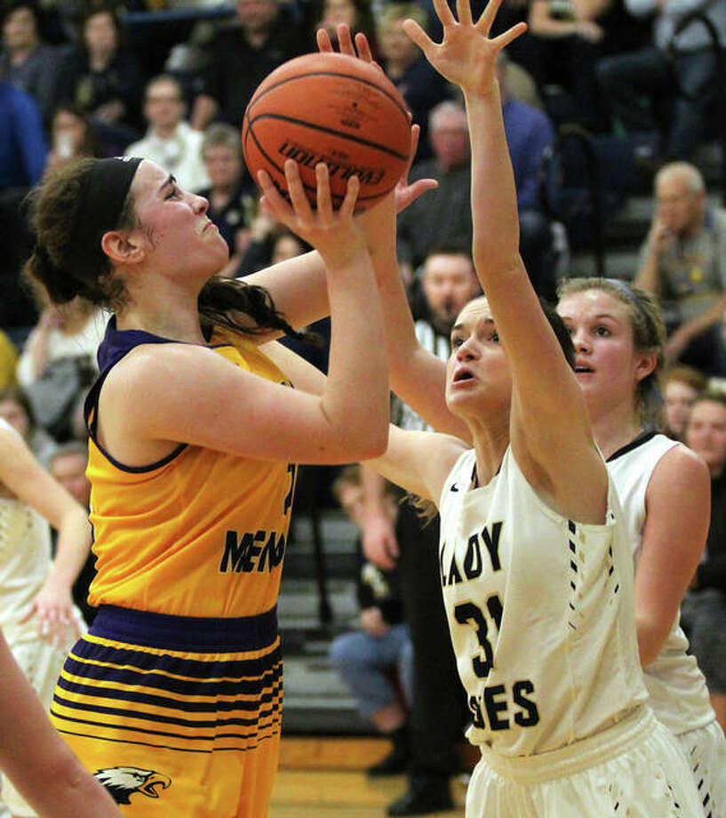 CM's Anna Hall (left) shoots over T-Town's Karsyn Mette. Hall scored a team-high 17 points for the Eagles. Photo: Greg Shashack / The Telegraph